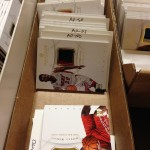 Cards awaiting their future autos.
