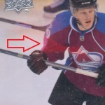 Print defect on Nathan MacKinnon Upper Deck Series 1 Young Guns card.