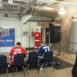 Anthony Mantha posing for his hockey card photos