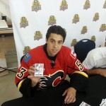 Johnny Gaudreau with his 2014-15 Fleer Ultra rookie card